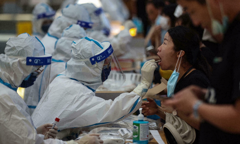 A cluster of infections in Nanjing city linked to airport workers who cleaned a plane from Russia earlier this month had reached the capital Beijing and five provinces by Friday. — AFP/File