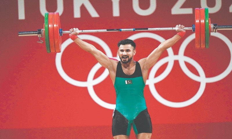 Pakistan's Talha Talib competes in the men's 67kg weightlifting event on Sunday. — AP
