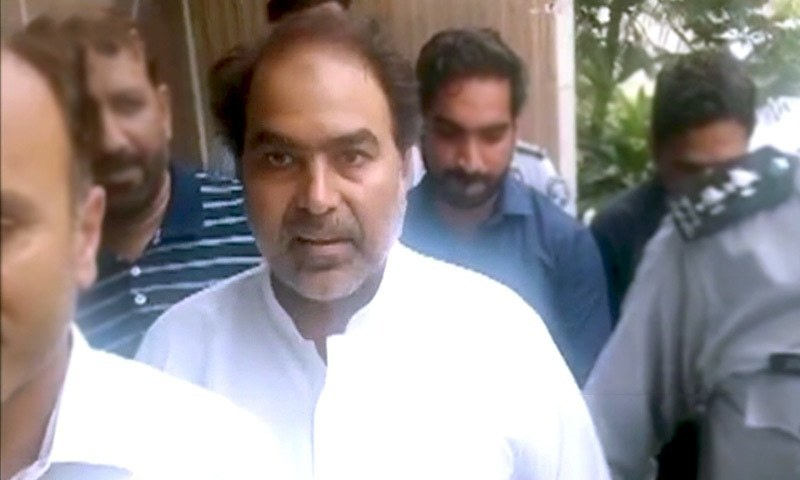 PTI MPA Nazir Chohan is led away after a district court remanded him to the Federal Investigation Agency's custody in Lahore on Thursday. — DawnNewsTV/File