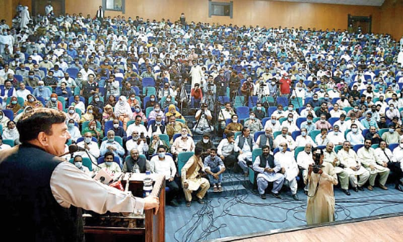 Interior Minister Sheikh Rashid Ahmed addresses workers of the municipal corporation during the oath-taking ceremony of its union at the Rawalpindi Arts Council on Saturday. — INP