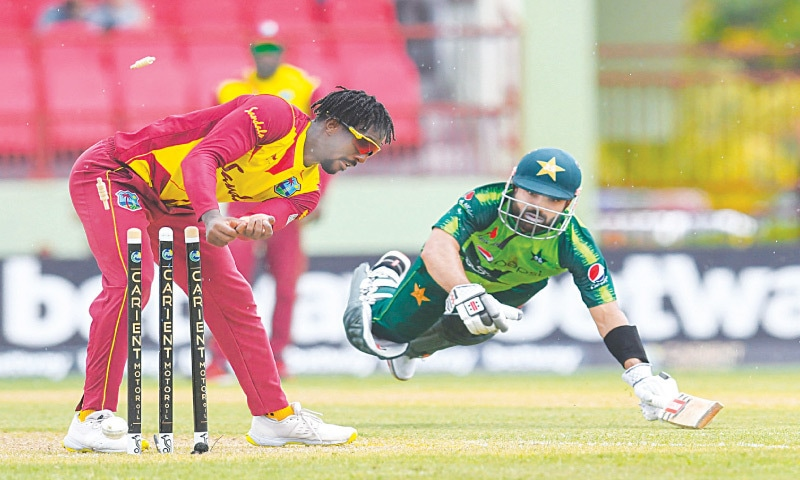 PROVIDENCE (Guyana): Mohammad Rizwan is run out by Hayden Walsh Jr during the second T20 International between the West Indies and Pakistan on Saturday.—AFP