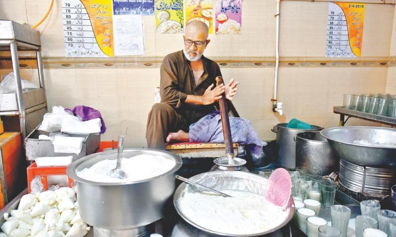 KARACHI: A Burns Road lassi-maker uses copious amounts of sugar to make the beverage. — Fahim Siddiqi / White Star