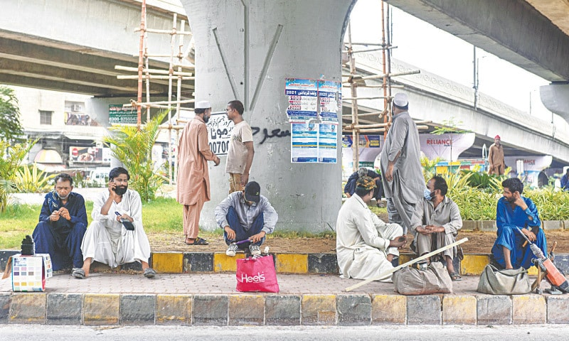 Daily wagers, who are the hardest hit during lockdowns, wait for work in the Water Pump area on Saturday.—Fahim Siddiqi/White Star