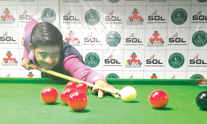 LAHORE: Muzammil Sheikh of Punjab in action against Islamabad's Hasnain Amir at the National U-17 Snooker Championship on Saturday.