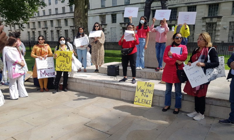 Members of the South Asian diaspora gather in London on Saturday to condemn violence against women. — Photo by Zoha Waseem