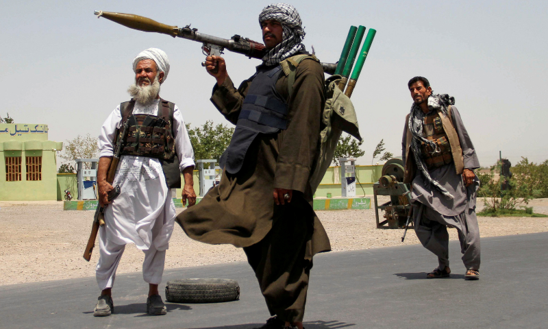 Former Mujahideen hold weapons to support Afghan forces in their fight against Taliban, on the outskirts of Herat province in this July 10 file photo. — Reuters