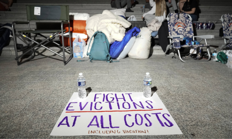 A sign calling for fighting evictions is set on the ground as Rep. Cori Bush (D-MO) spends the night outside the US Capitol to call for an extension of the federal eviction moratorium on Saturday in Washington. — AFP