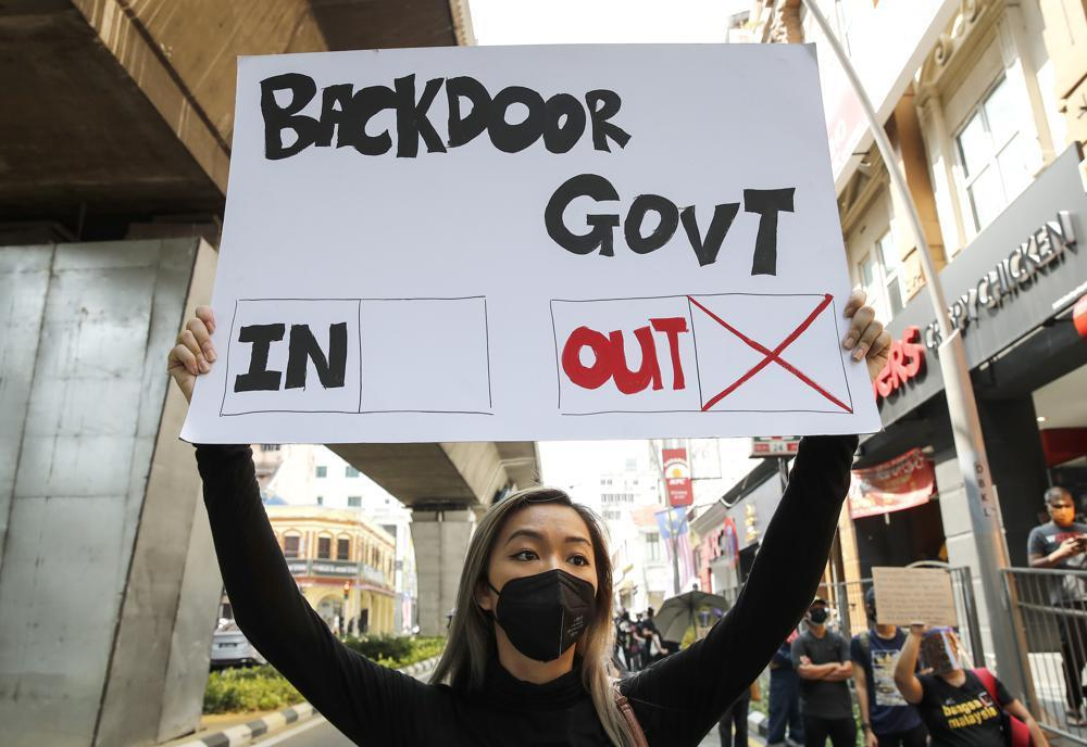 A protester holds a placard during a demonstration demanding the prime minister step down near the Independence Square in Kuala Lumpur, Malaysia on Saturday. — AP