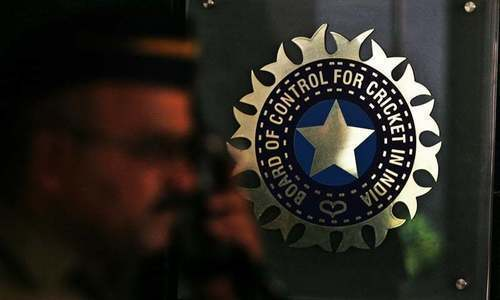 A policeman walks past a logo of the Board of Control for Cricket in Mumbai, India, April 26, 2010. — Reuters/File