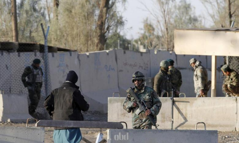 In this file photo, Afghan security forces stand guard at the entrance gate of Kandahar Airport. — Reuters/File