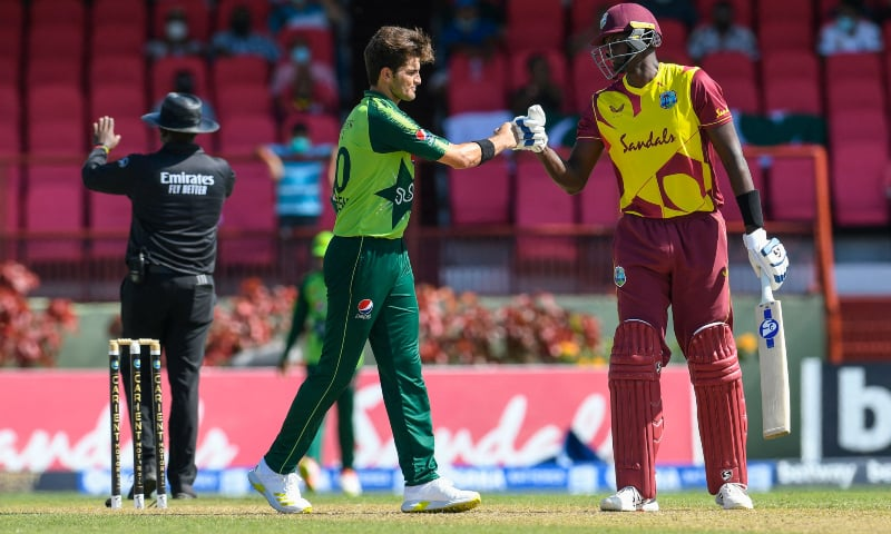 Jason Holder (R) of the West Indies congratulates Shareen Afridi (L) of Pakistan for winning the 2nd T20I match between the West Indies and Pakistan at Guyana National Stadium in Providence, Guyana, on July 31. — AFP/File