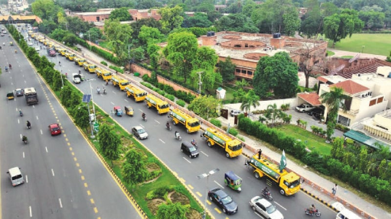 Parks & Horticulture Authority trucks line up for 'flag march' held to promote tree plantation. — Dawn