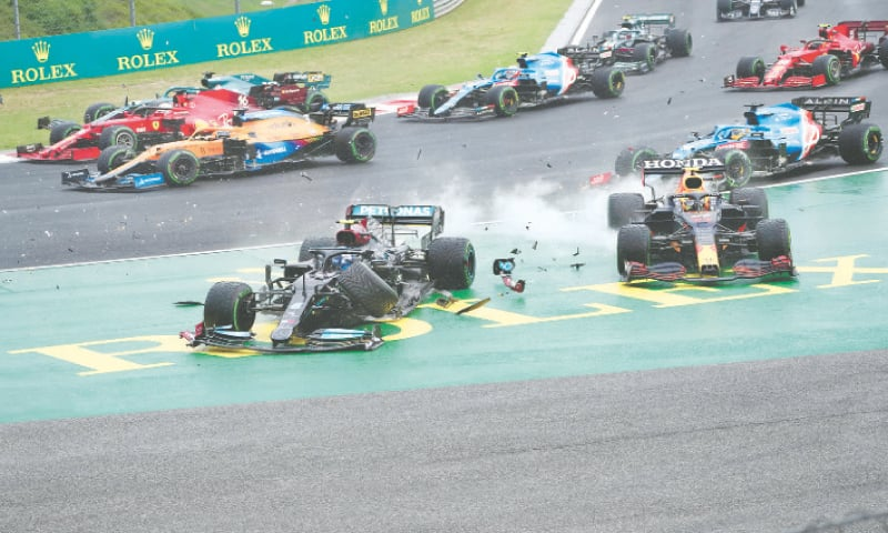 BUDAPEST: Mercedes' Valtteri Bottas (front L) steers his car out of the track after a crash with Red Bull's Sergio Perez during the Hungarian Formula One Grand Prix at the Hungaroring racetrack on Sunday.—AP