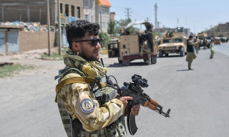 An Afghan National Army commando stands guard along the road in Enjil district of Herat province on August 1, 2021, as skirmishes between Afghan National Army and Taliban continue. — AFP