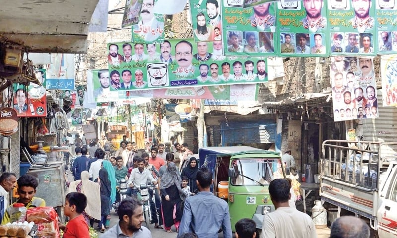 In this file photo, banners of political parties are displayed in Lahore during a local government election. —  Azhar Jafri/White Star