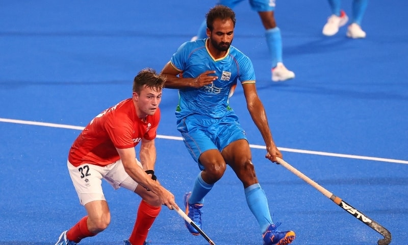 Zachary Wallace of Britain in action against Gurjant Singh of India.