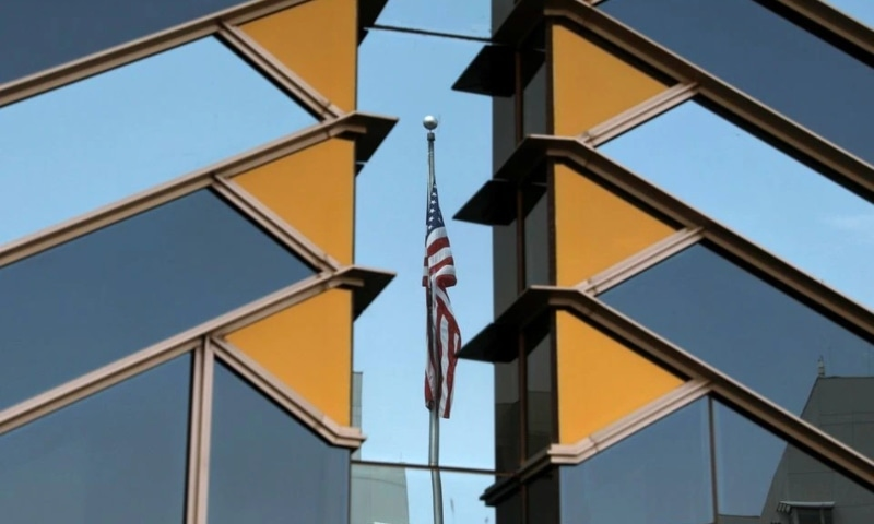The US flag is reflected on the windows of the US Embassy in Kabul, Afghanistan, July 30. — Reuters