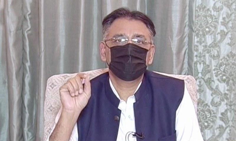 Federal planning minister Asad Umar speaks at a press conference. — DawnNewsTV