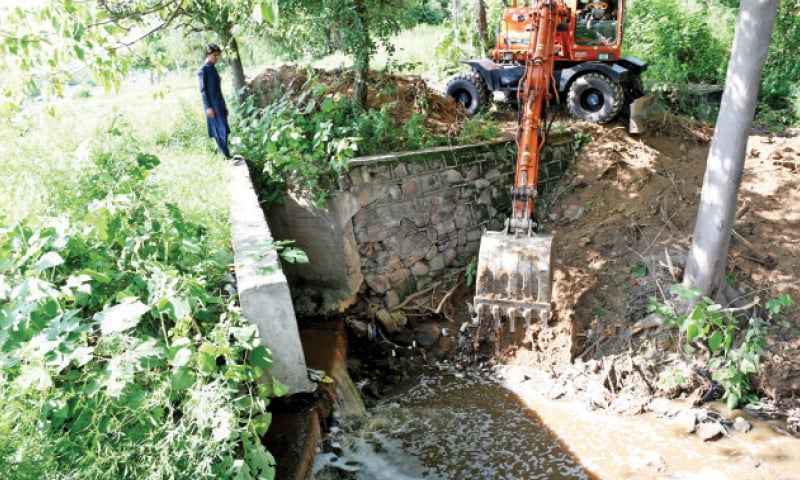 CDA continues with its dredging work in a nullah in I-10 on Monday. — White Star