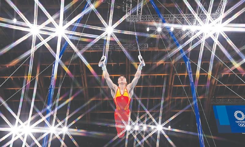 CHINA'S Liu Yang competes to win the artistic gymnastics men's rings final at the Ariake Gymnastics Centre.—AFP