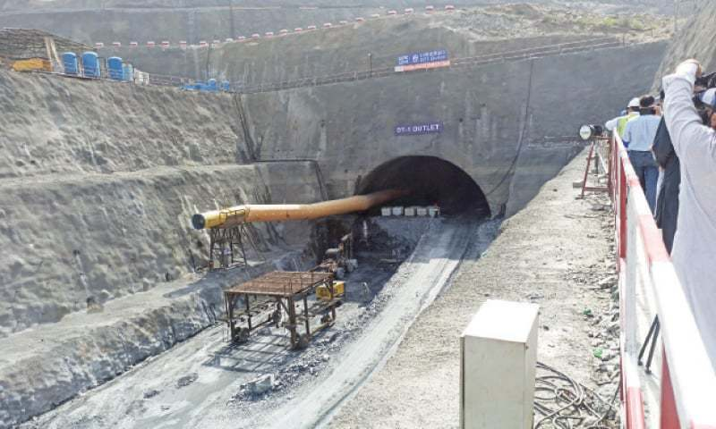 In this file photo, construction work is in progress on the diversion tunnel of Mohmand Dam. — Dawn