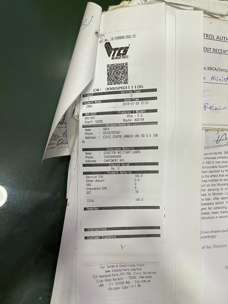 Courier receipt for document sent to Military Lands & Cantt Karachi Region Director.