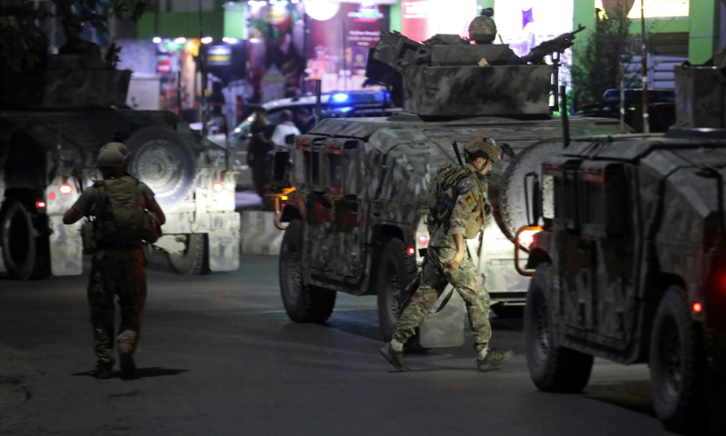 Afghan security personnel arrive at the site of a powerful explosion in Kabul, Afghanistan on Tuesday. — AP