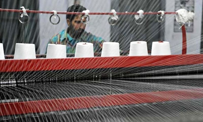 In this file photo, a man works at a textile factory in Pakistan. — AFP/File