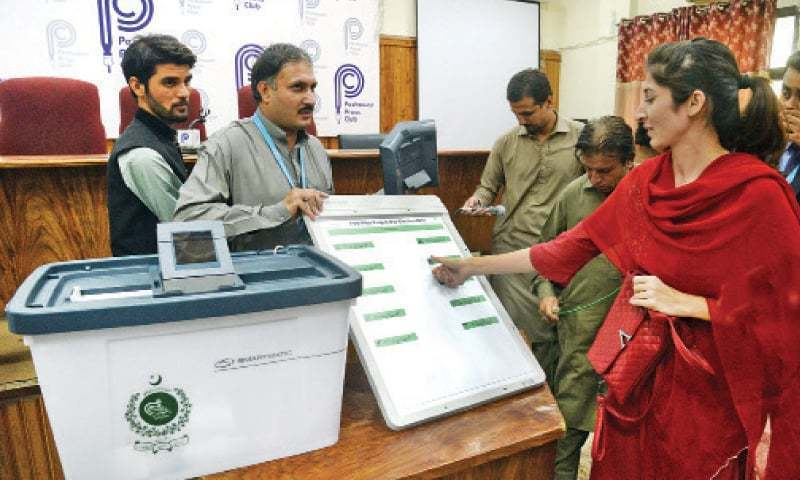 In this file photo, a woman casts her vote through the i-voting system. — Dawn/File