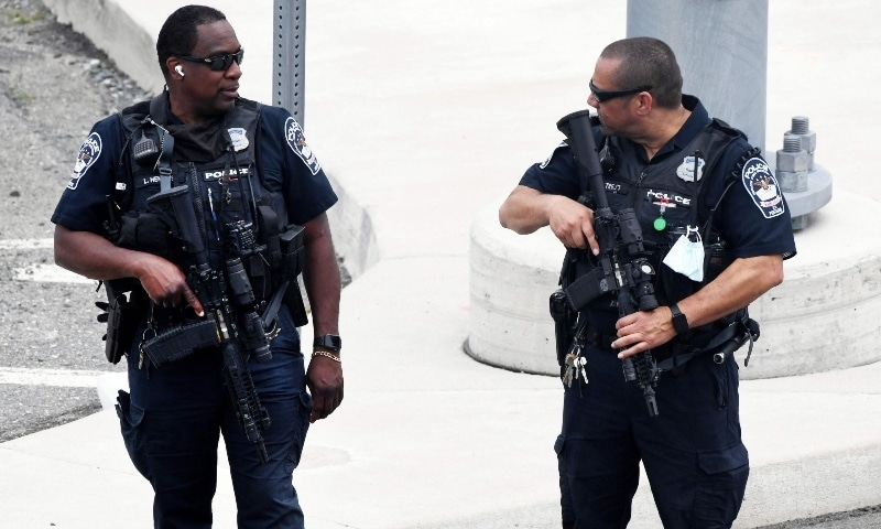 Law enforcement officers patrol near the entrance of the Pentagon after a report of an active shooter and lockdown in Washington, DC on August 3. — AFP