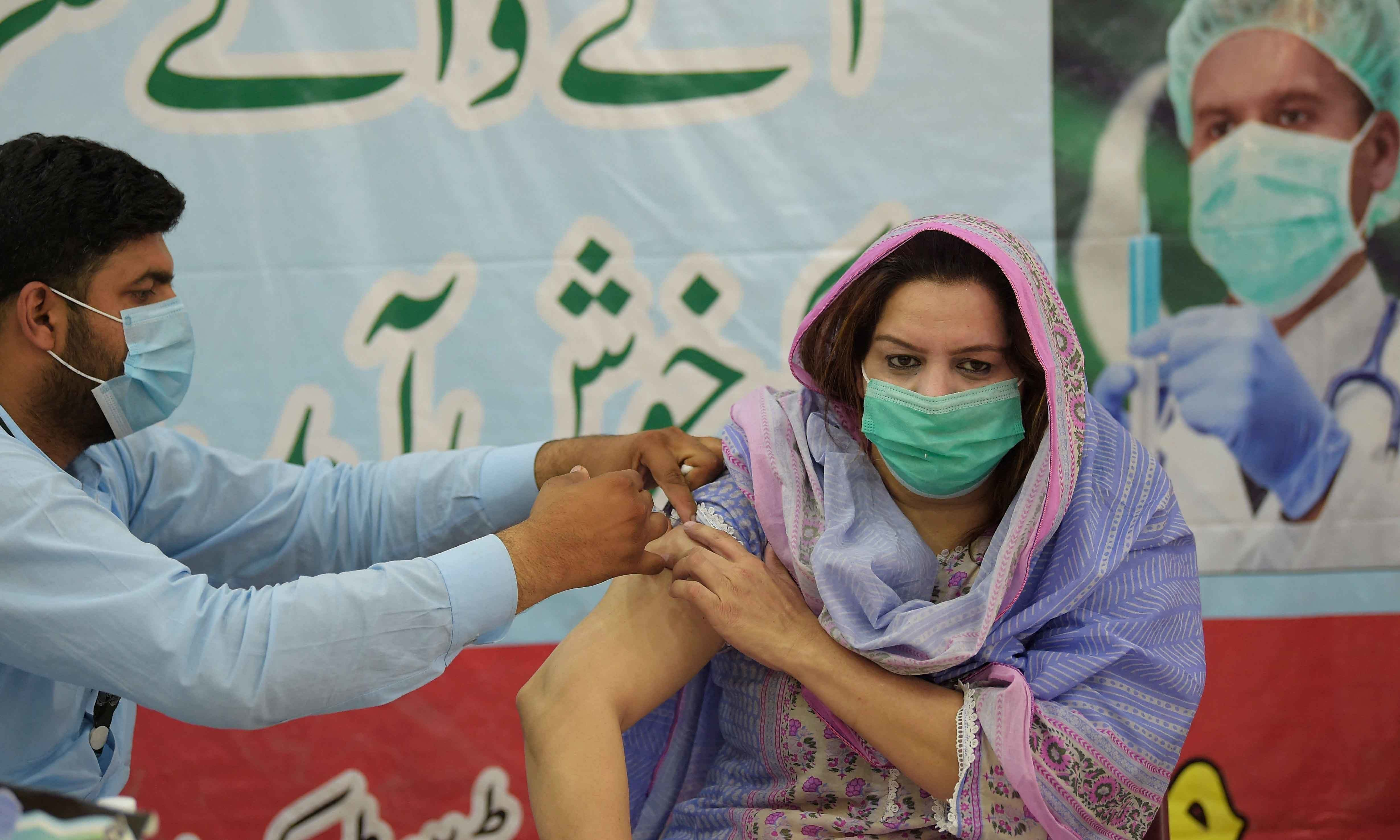 A health worker inoculates a media person with a dose of the Covid-19 coronavirus Sinovac vaccine at a vaccination centre in Rawalpindi on May 25. — AFP/File
