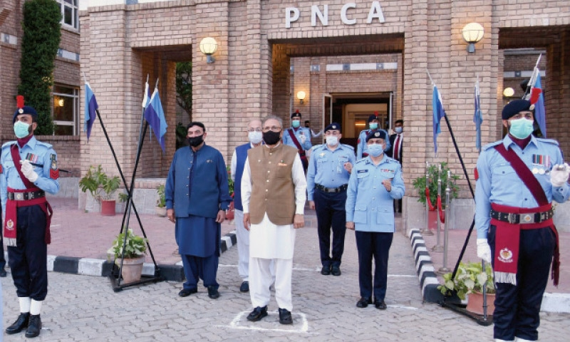 President Dr Arif Alvi reviews a guard of honour outside the PNCA in Islamabad on Wednesday where an event was held to pay tributes to the police martyrs. Interior Minister Sheikh Rashid and IGP Qazi Jameelur Rehman are also present. — White Star