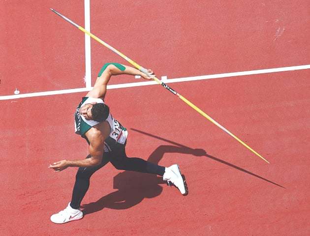 TOKYO: Arshad Nadeem throws javelin during the qualifying round at the Olympic Stadium on Wednesday. After reaching 78.50 metres in his first attempt, Arshad regrouped and with his second throw he made history by scoring 85.16 metres. He will take part in the final on Aug 7, keeping Pakistan's hope for a medal alive.—Reuters