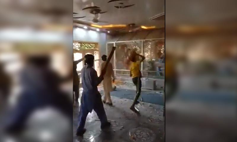 This image shows a mob vandalising a Hindu temple in Bhong town. — DawnNewsTV