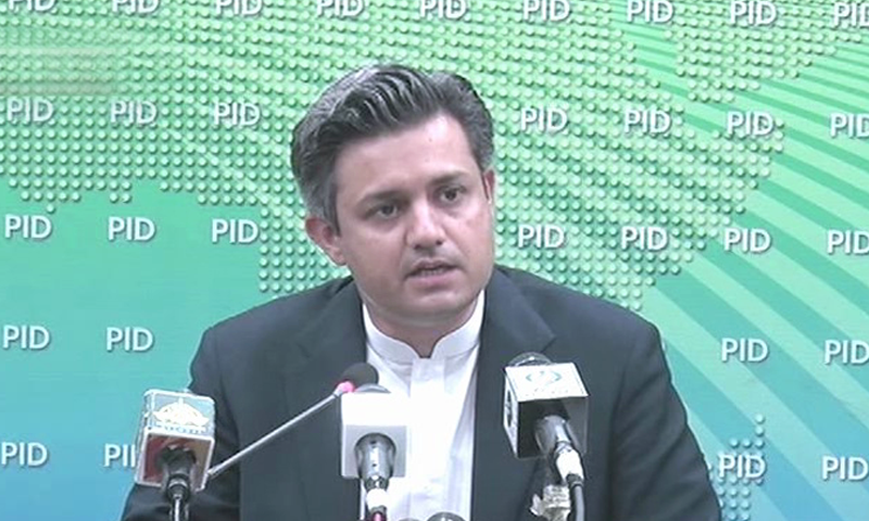 In this file photo, Finance Minister Hammad Azhar is addressing a press conference after chairing a meeting of the Economic Coordination Committee. — DawnNewsTV/File