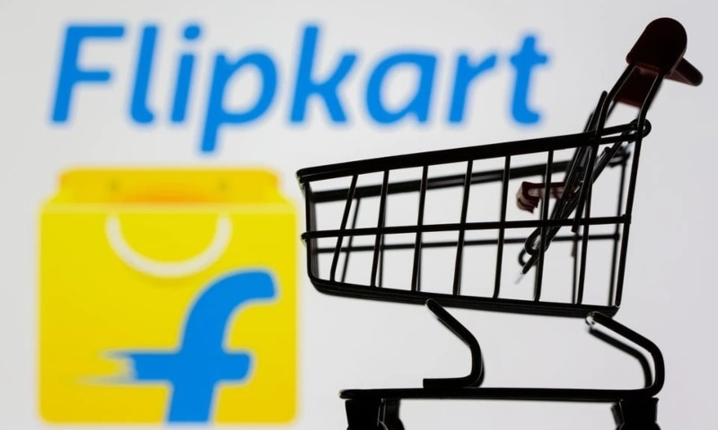 A small toy shopping cart is seen in front of the Flipkart logo in this illustration taken on July 30. — Reuters
