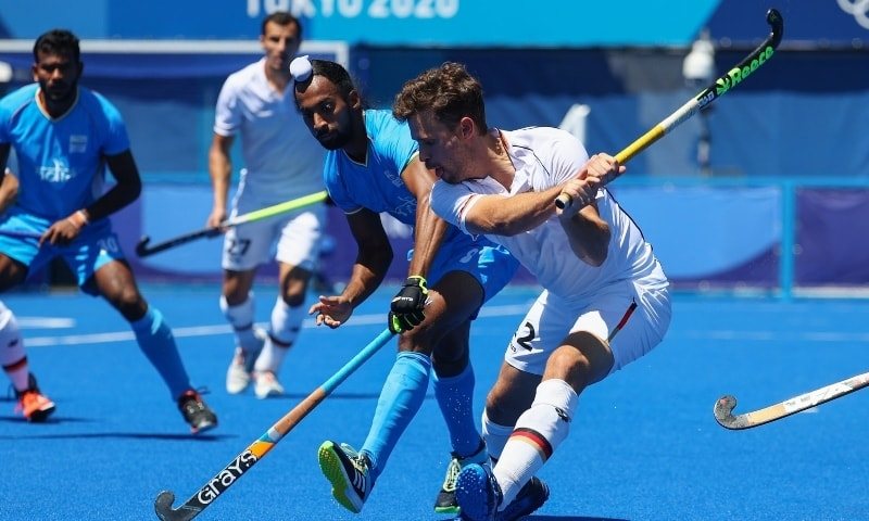 Hardik Singh of India in action against Timm Herzbruch of Germany during the men's field hockey bronze medal match at the 2020 Summer Olympics on August 5. — Reuters