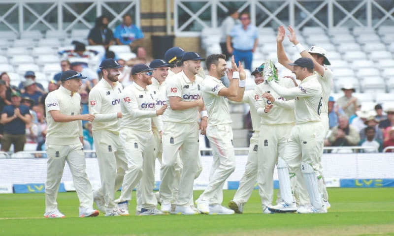 NOTTINGHAM: England seamer James Anderson (without cap) celebrates with team-mates after taking the prized wicket of Indian captain Virat Kohli during the first Test at Trent Bridge on Thursday.—AP