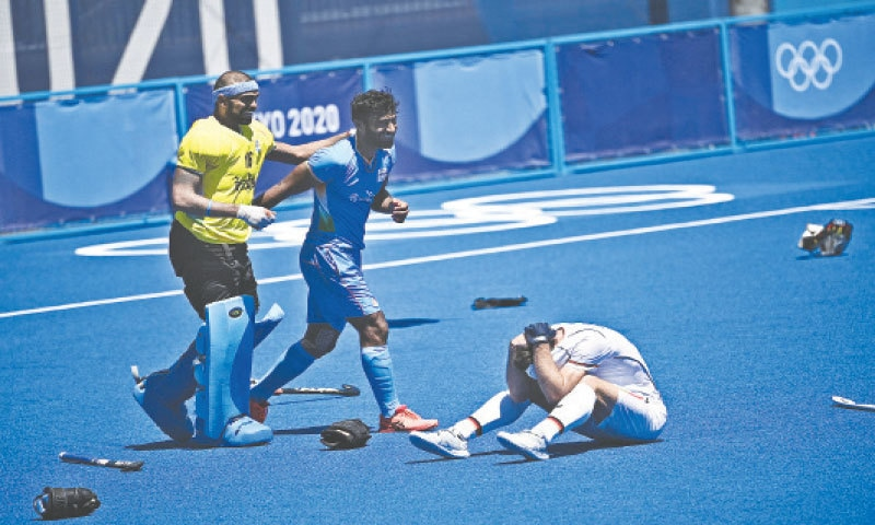 INDIAN goalkeeper Sreejesh Parattu Raveendran and a team-mate celebrate after winning the bronze medal match against Germany at the Oi Hockey Stadium on Thursday. —AFP