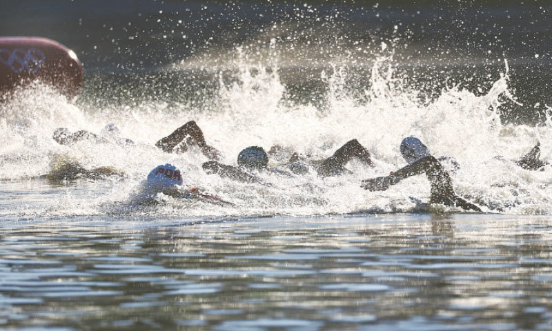 COMPETITORS in action during the men's 10km open water final at the Odaiba Marine Park.—Reuters