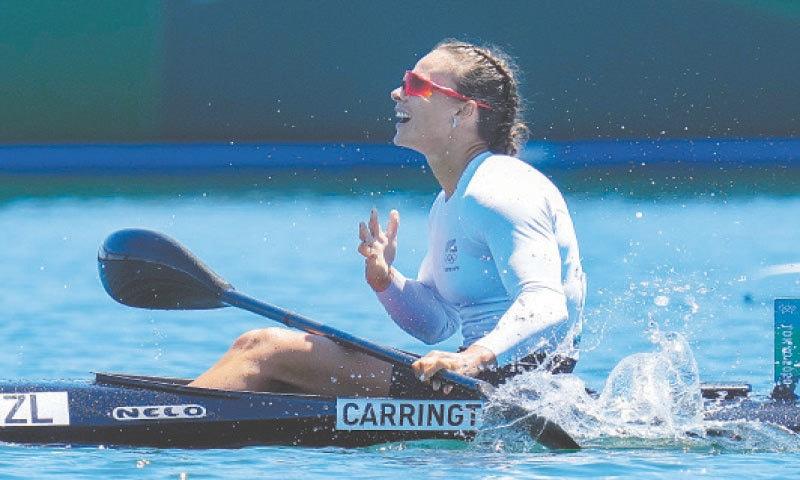 LISA Carrington of New Zealand celebrates after winning the women's kayak single 500m final.—AP