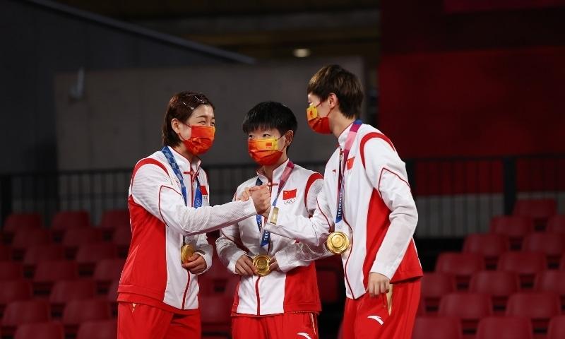 Gold medallists Chen Meng of China, Wang Manyu of China and Sun Yingsha of China on the podium. — Reuters