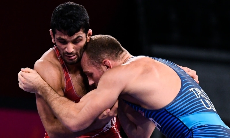 Hassan Yazdanicharati of Iran in action against David Taylor of the United States. — Reuters