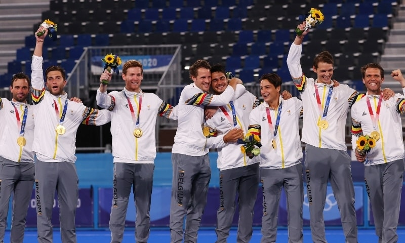 Players of Belgium celebrate on the podium after receiving their gold medals. — Reuters