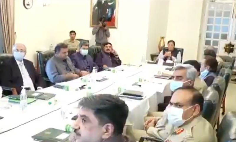 A screengrab from the video of a meeting presided over by Prime Minister Imran Khan on Thursday to review the law and order situation in the country and the implementation status of the 2014 National Action Plan. — Photo courtesy Prime Minister's Office Twitter