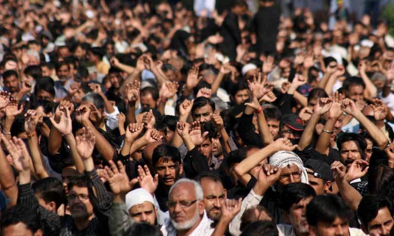 In this file photo, mourners raise their hands during a Muharram mourning procession. — INP/File