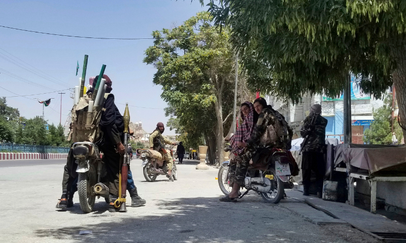 Taliban fighters patrol inside the city of Ghazni, southwest of Kabul, Afghanistan on Thursday. — AP