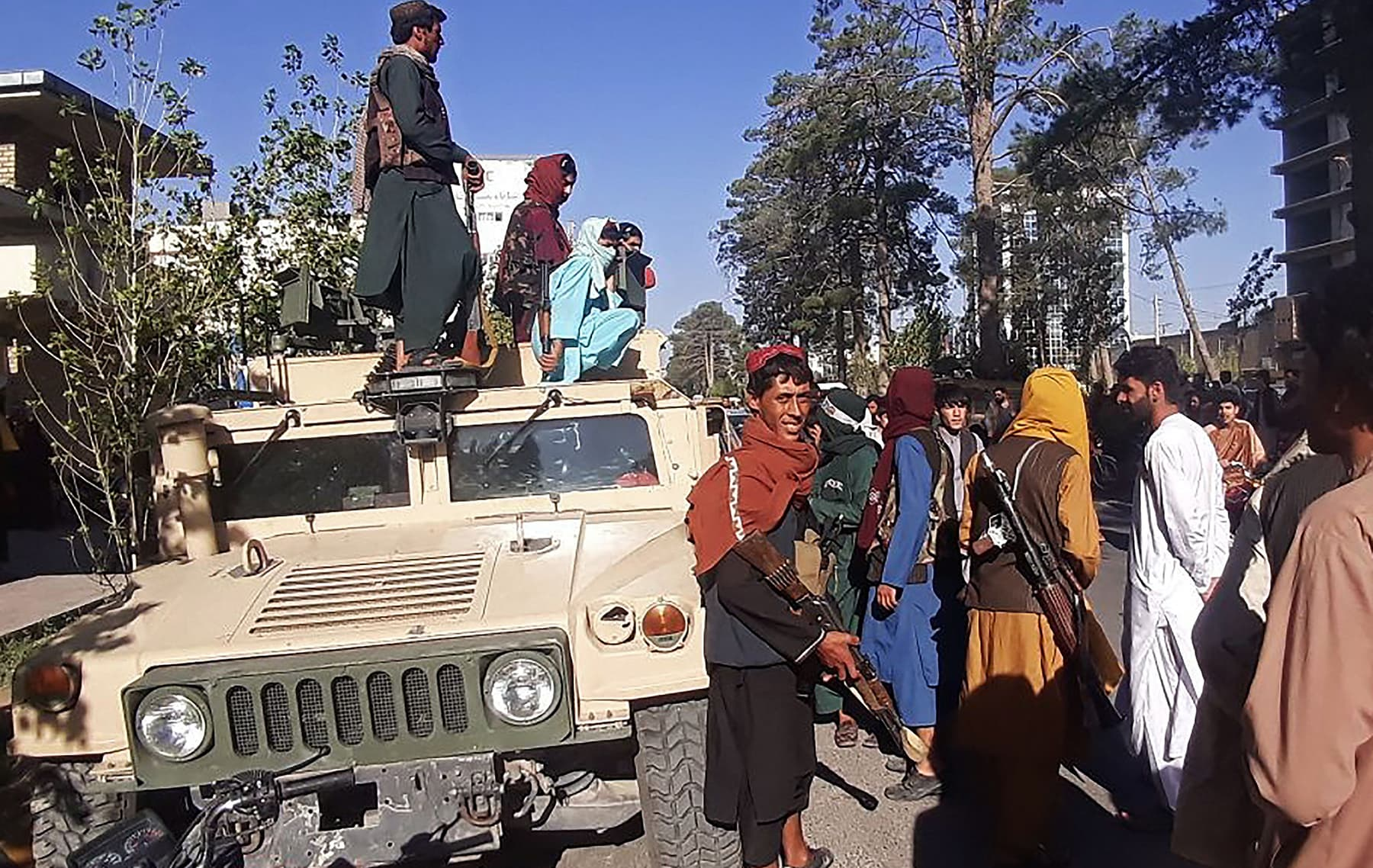In this picture taken on August 13, Taliban fighters stand guard along the roadside in Herat, Afghanistan's third-biggest city, after government forces pulled out the day before following weeks of being under siege. — AFP