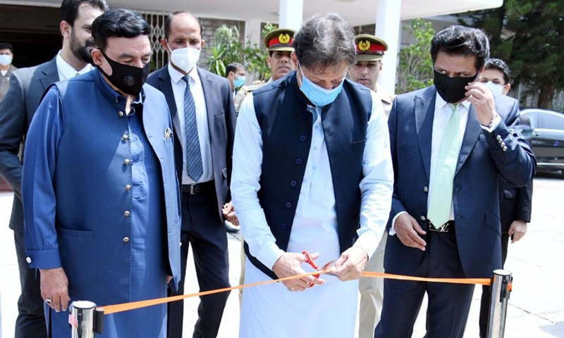 Prime Minister Imran Khan inaugurates Alien Registration Card, mobile vaccination pass and other projects at NADRA headquarters on Friday. — Photo courtesy PID website