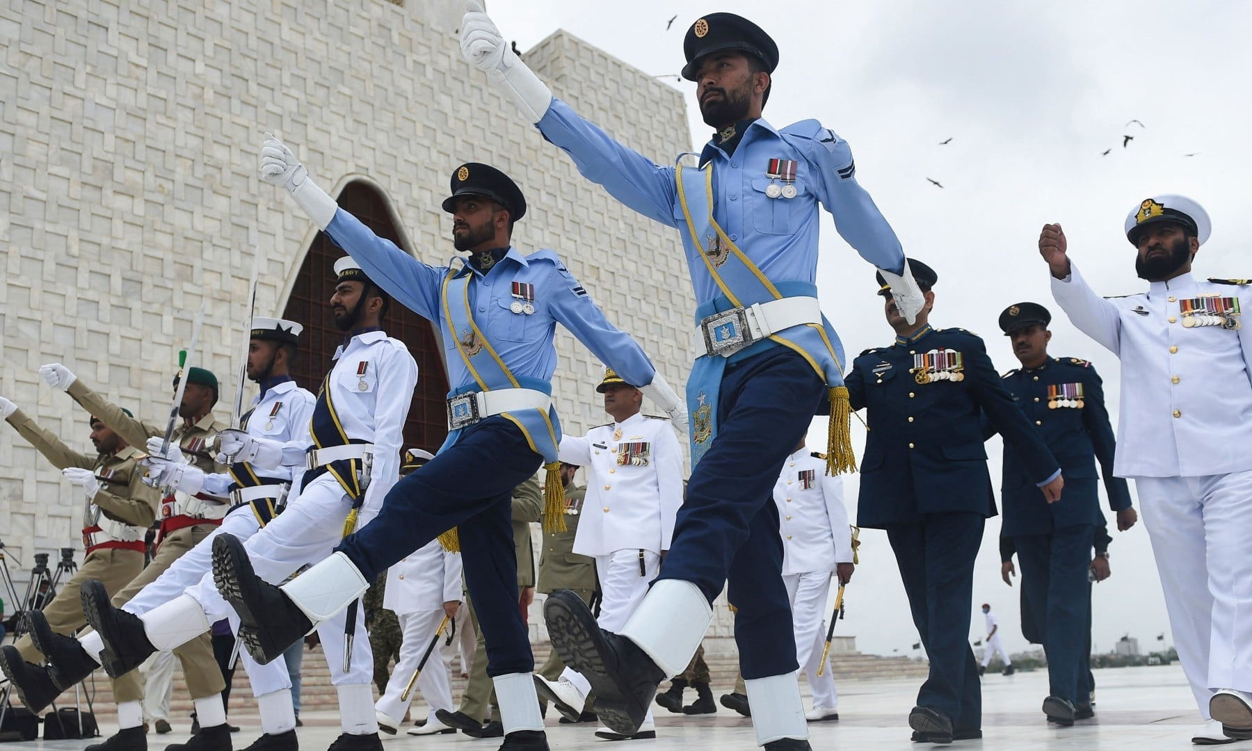Pakistan's Army, Navy and Air Force soldiers march at Quaid-i-Azam's mausoleum during Independence Day celebrations in Karachi on August 14. — AFP